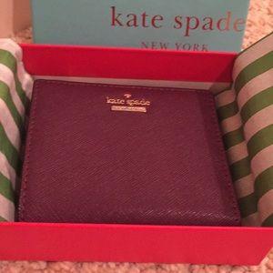 Kate Spade wallet. New with original packaging.
